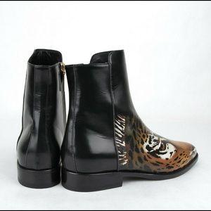 Saint Laurent women,s leather w tiger print boots.